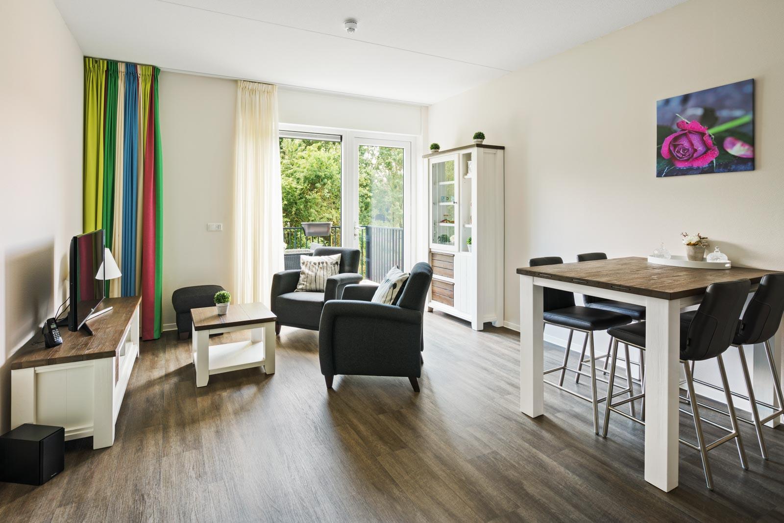 Foto van een woonkamer in een appartement bij SDW Woonlocatie 't Zand